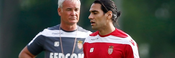 Colombian striker Radamel Falcao, newly-signed player for French Ligue 1 soccer club AS Monaco, walks by AS Monaco coach Claudio Ranieri during a training session in La Turbie