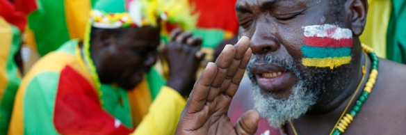 Togo supporters pray during their African Nations Cup (AFCON 2013) Group D soccer match against Ivory Coast in Rustenburg