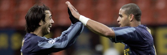 Inter Milan's Adriano (R) jubilates with